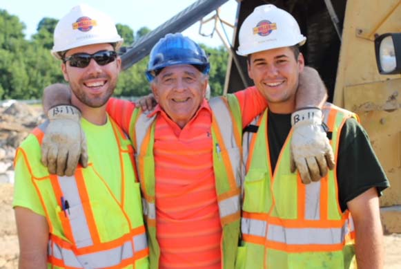 Bill Utz shares a laugh with two assistant project managers